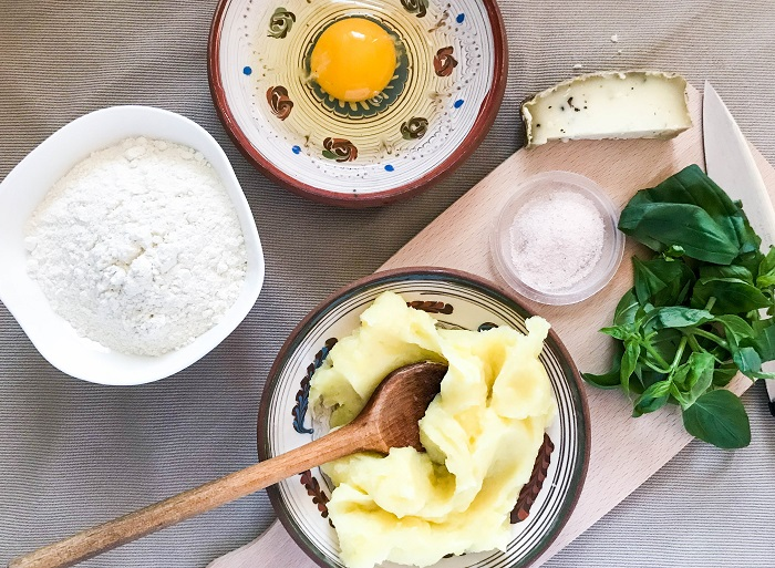 Ingredients for fresh gnocchi: flour, egg, mashed potatoes, chopped basil, grated cheese, salt